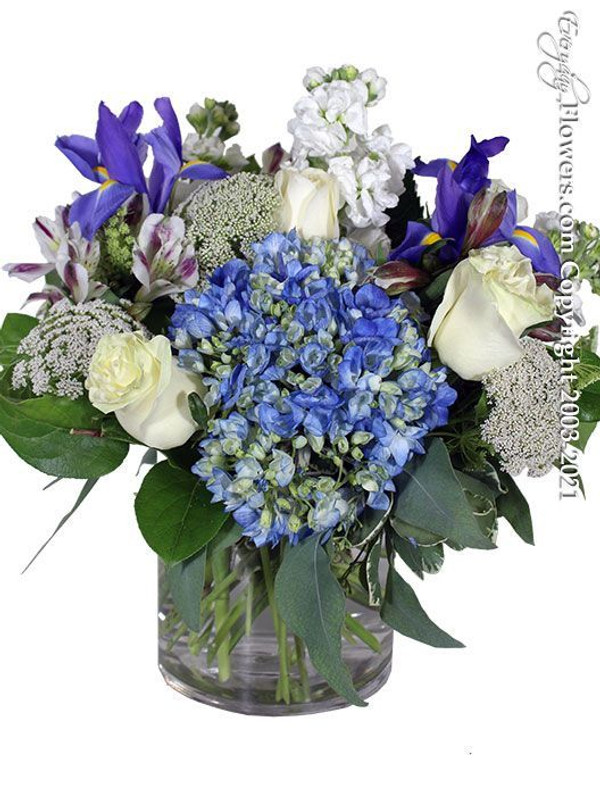 Blue and White flower arrangement featuring hydrangea roses stock and iris.