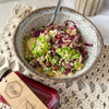 This meal is a fresh spring salad with a zesty lemon dressing. Packed with mineral dense broccoli, cabbage and high protein quinoa this salad is also filling. We then top it with some slivered almonds and dried cranberries for extra crunch.