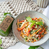 This meal is a mix of red capsicum, cucumber and carrot with lots of herbs for flavour. It also has rice noodles to make it filling. The sauce is a sweet and spicy mix of red onion, chilli and a special vegan fysh sauce. We top it with peanuts for some crunch!