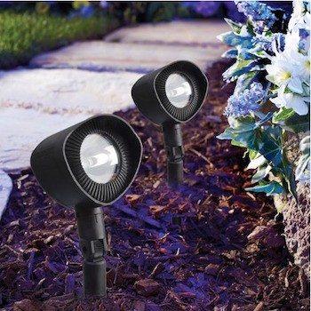 Solar spotlights in flower bed as landscape lighting
