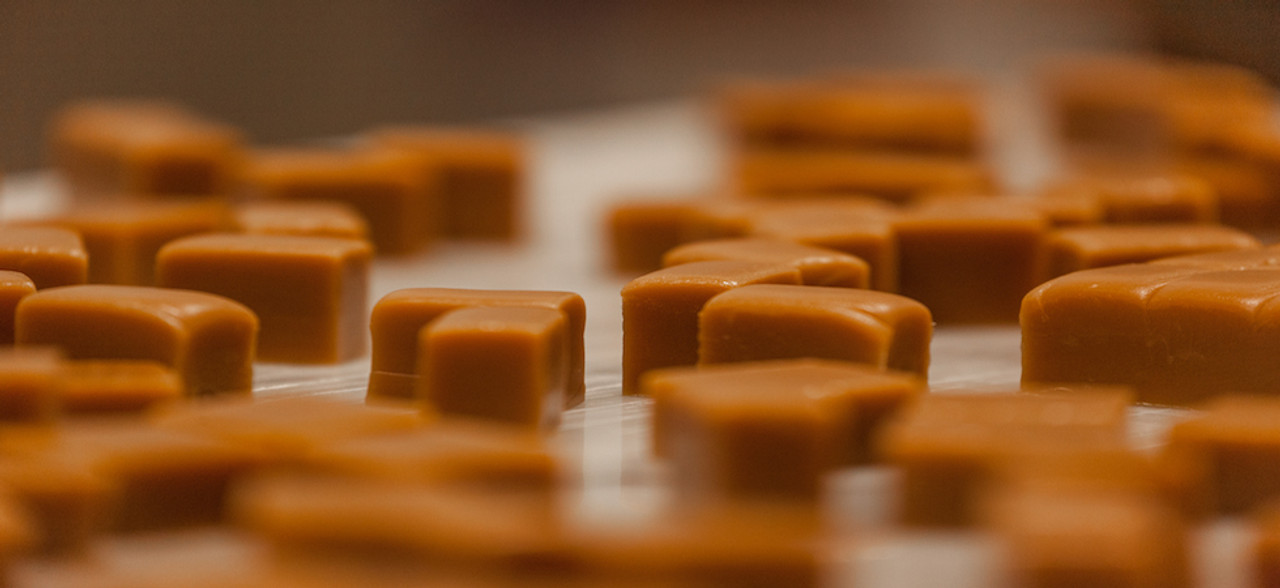 Fresh cut squares of vanilla caramel