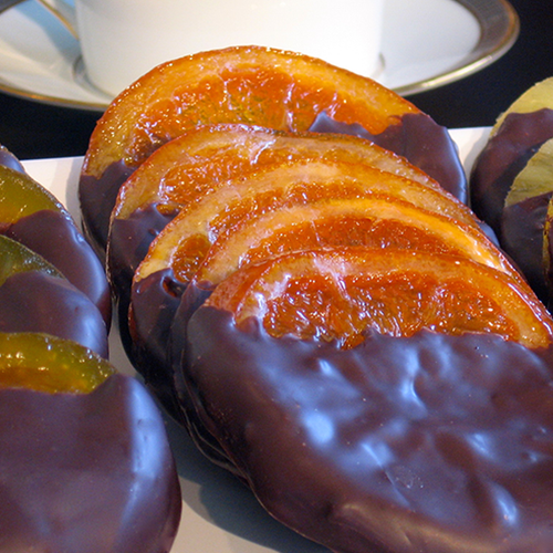 Slices of real orange, candied and half dipped in dark chocolate