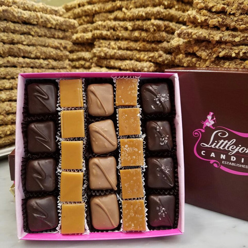Rows of vanilla caramels and salted caramels with and without chocolate in a gift box