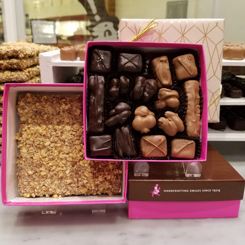 2 layers of your favorite candy 1 layer of Caramels, Nuts, Pecan Toffee dipped in our Milk or Dark Chocolate  1 Layer of our World Famous English Toffee