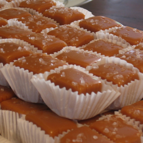 Salted Caramel squares in white paper cups