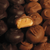 Milk chocolate and dark chocolate covered buttercreams cut in half to show cream center