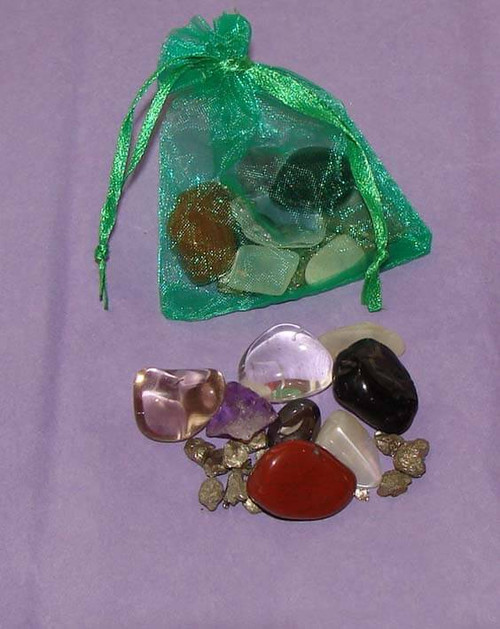 Set of the Best Healing Stones for Safe Travels in a green organza pouch