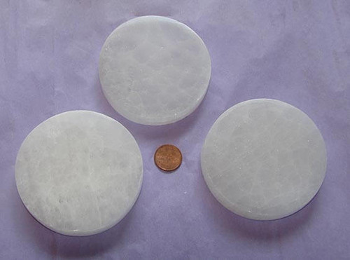 Round Selenite Charging Plate from Morocco, approximately 3 inch diameter by 5/8 inch thick