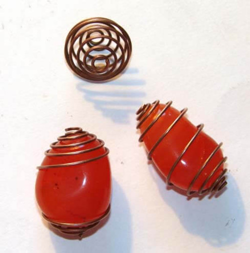 Small copper colored tumbled gemstone cages