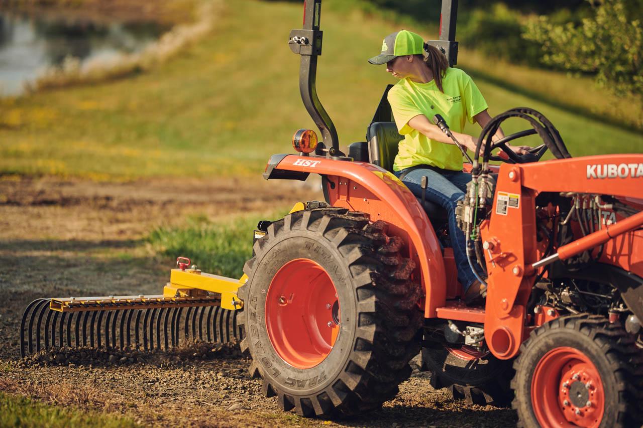 Independence Landscape Rake re-grading gravel road.