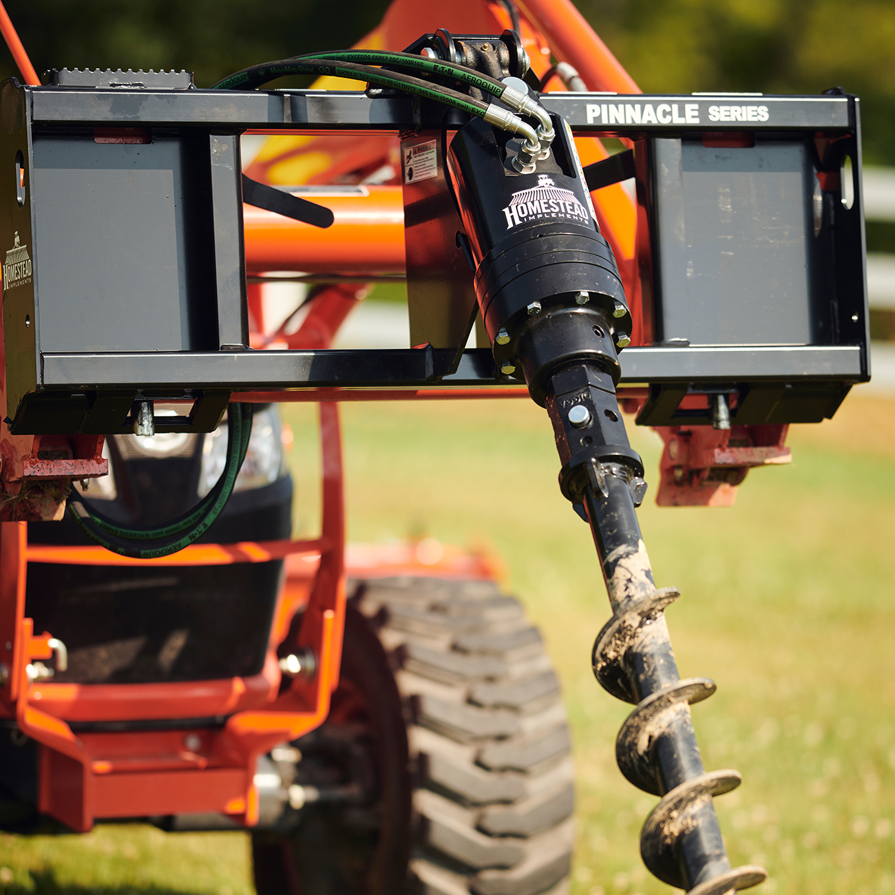 Front-End Post-Hole digger attached to tractor.