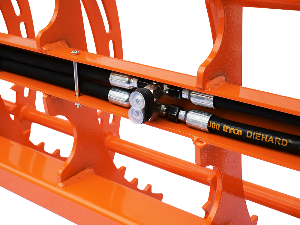 Closeup view of secured hydraulic hoses.