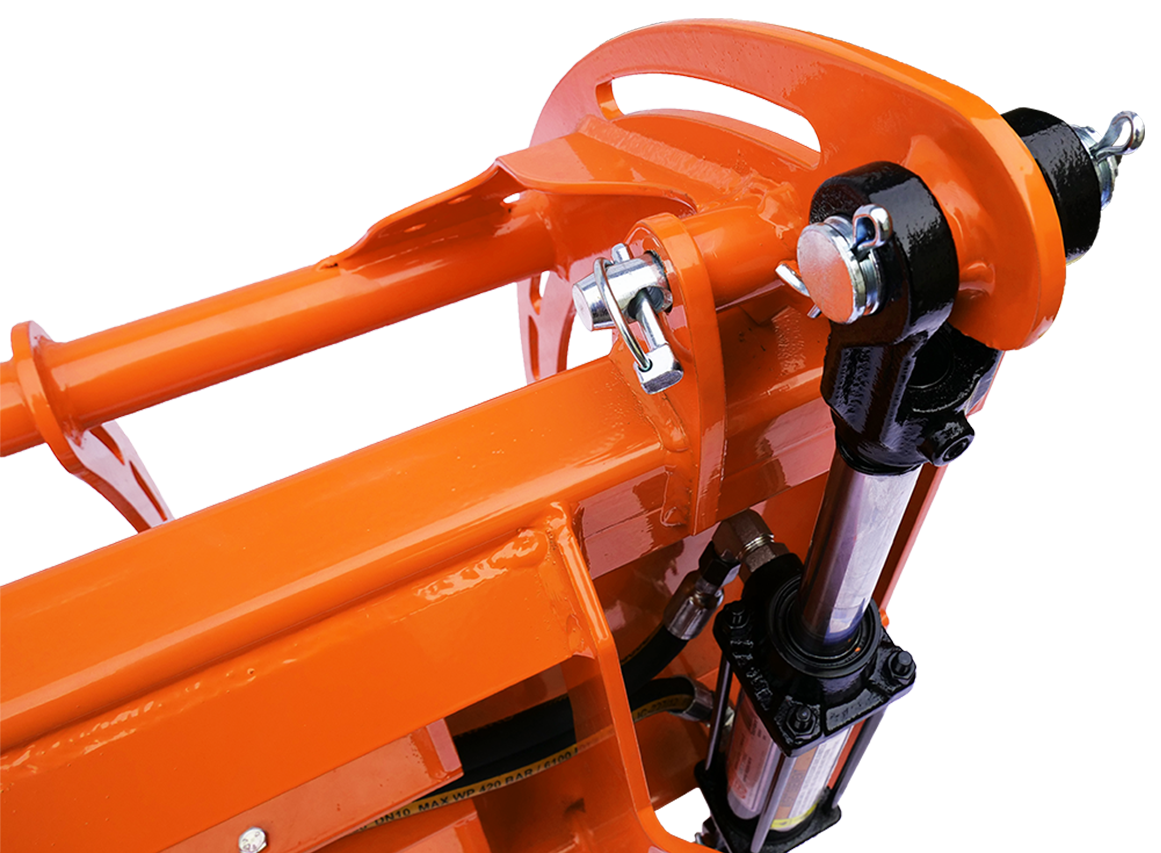 Closeup view of hydraulic cylinder and hinge point.