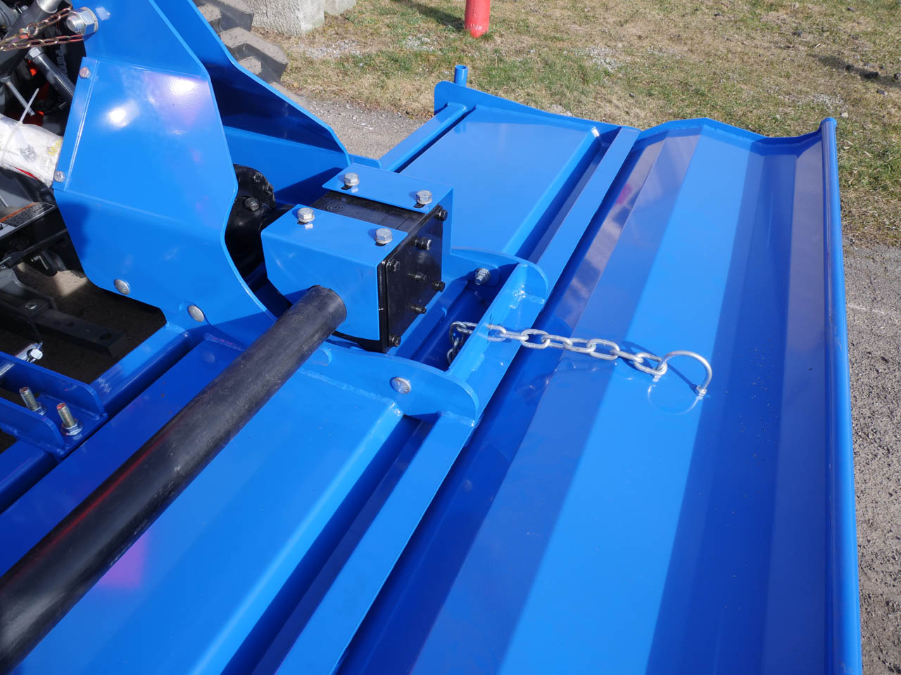 Rear tailgate and adjustable chain of Rotary TIller.
