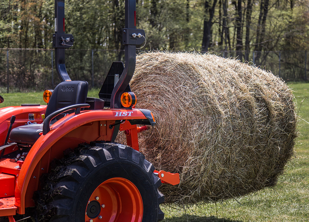 Closeup of Quick-Hitch spear with round bale.