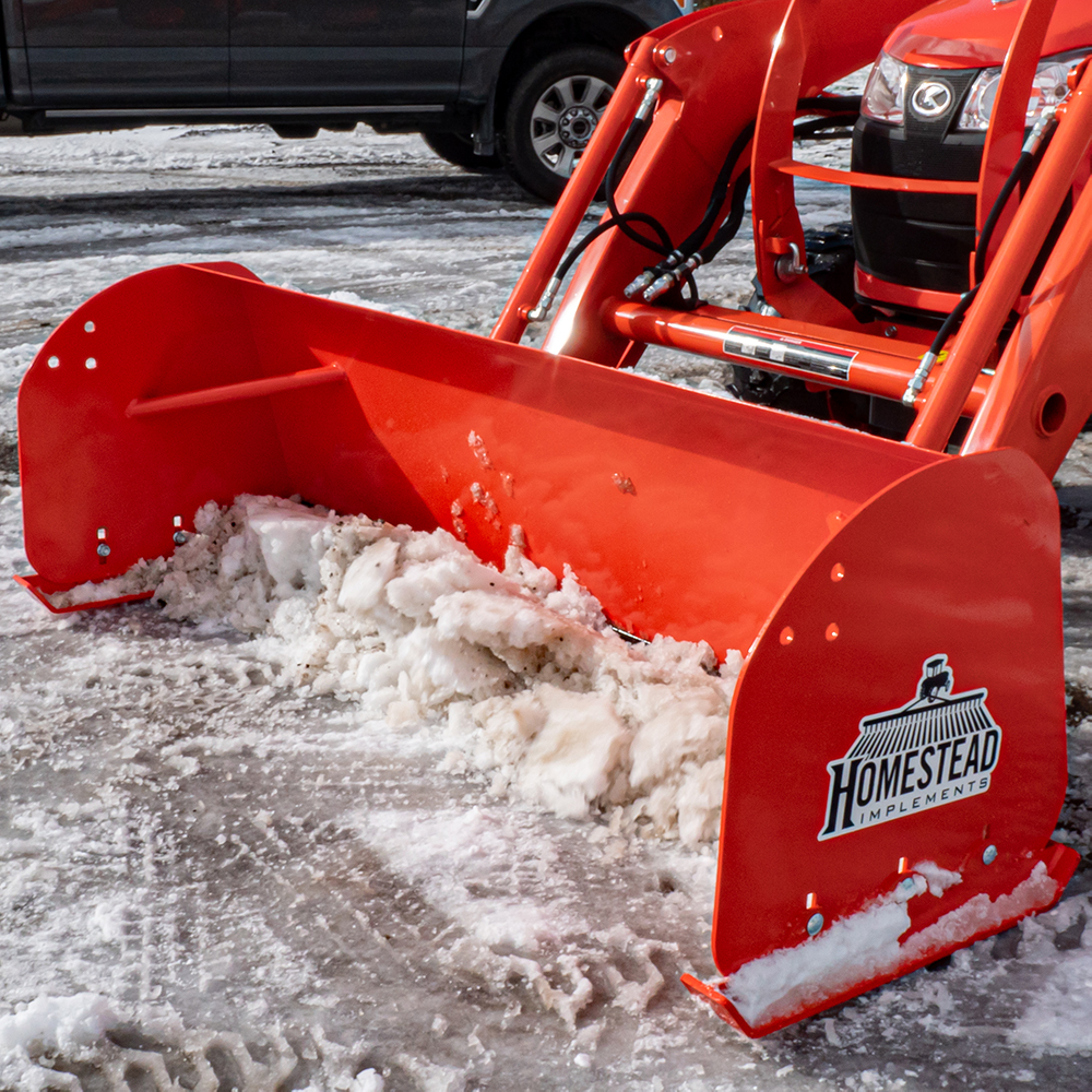 Pinnacle Series Snow Pusher, Front View with Snow