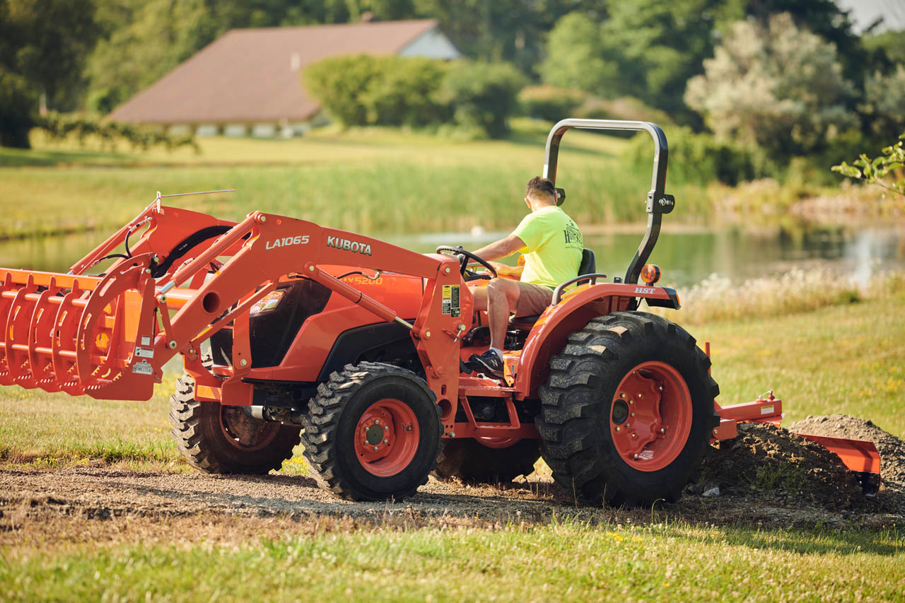 Tractor pulling dirt with Pinnacle Series Back Blade