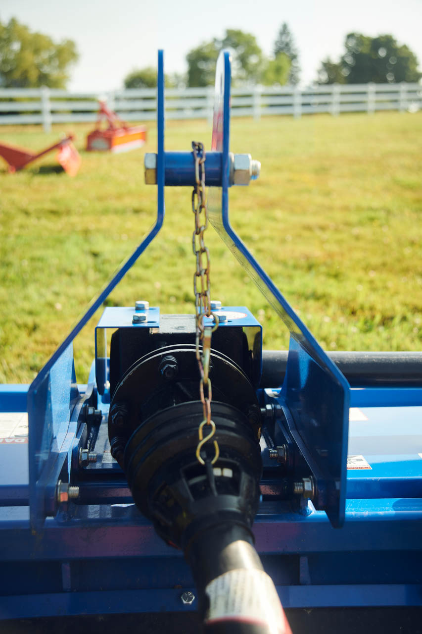 Driveline and upright arms with adjustable chain.
