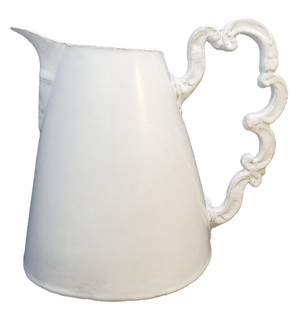 White Astier de Villatte pitcher with whimsical handle.