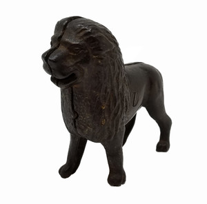 Antique iron lion coin bank.