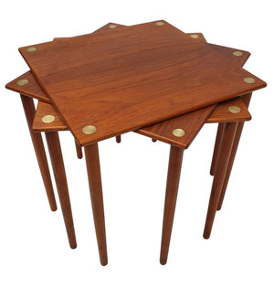 Scandinavian midcentury modern stacking tables made from teak wood with brass details.