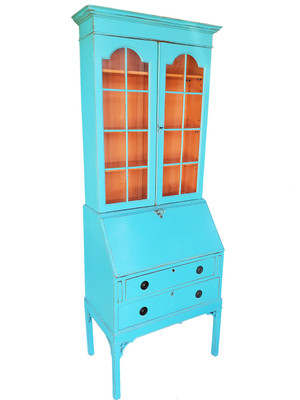 Unique turquoise painted secretary desk with glass-fronted cupboard and bright orange interior.