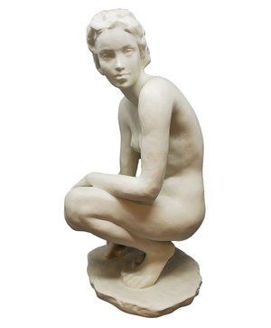 Porcelain sculpture of a nude female crouched on her heels.