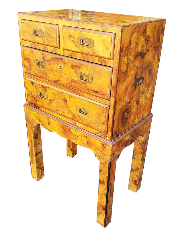 Campaign-style drop front cabinet with organic marquetry in golden colored olive wood.