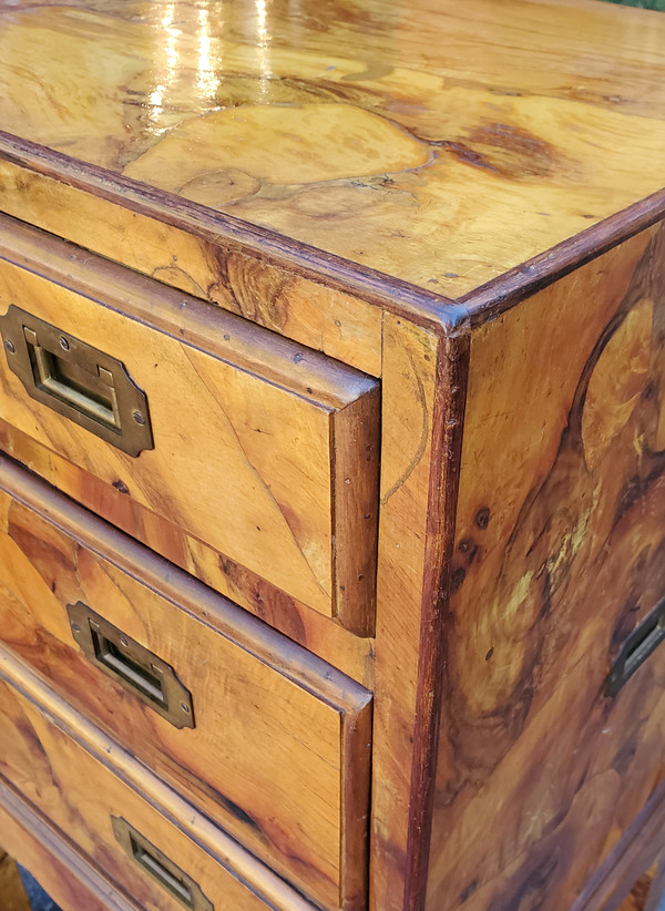 Some natural wear showing on corners of olive wood cabinet.