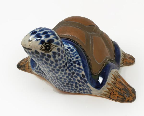 Smiling face of ceramic Bustamante turtle.