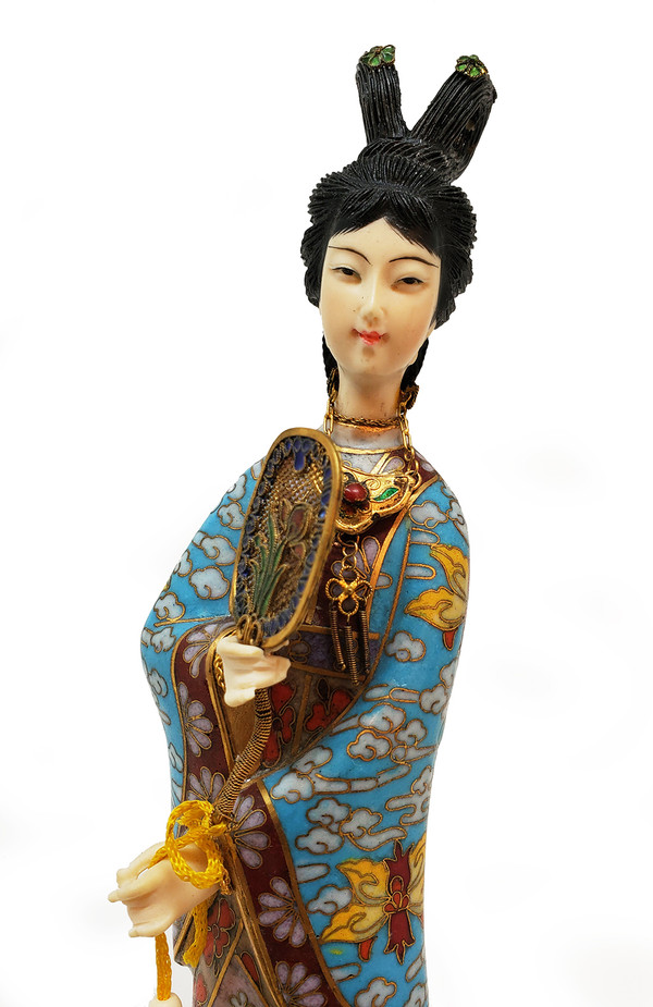 Geisha figure with attached jewelry and tasseled fan.