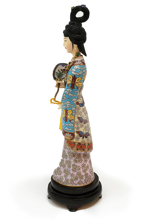 Cloisonne geisha figurine in profile.