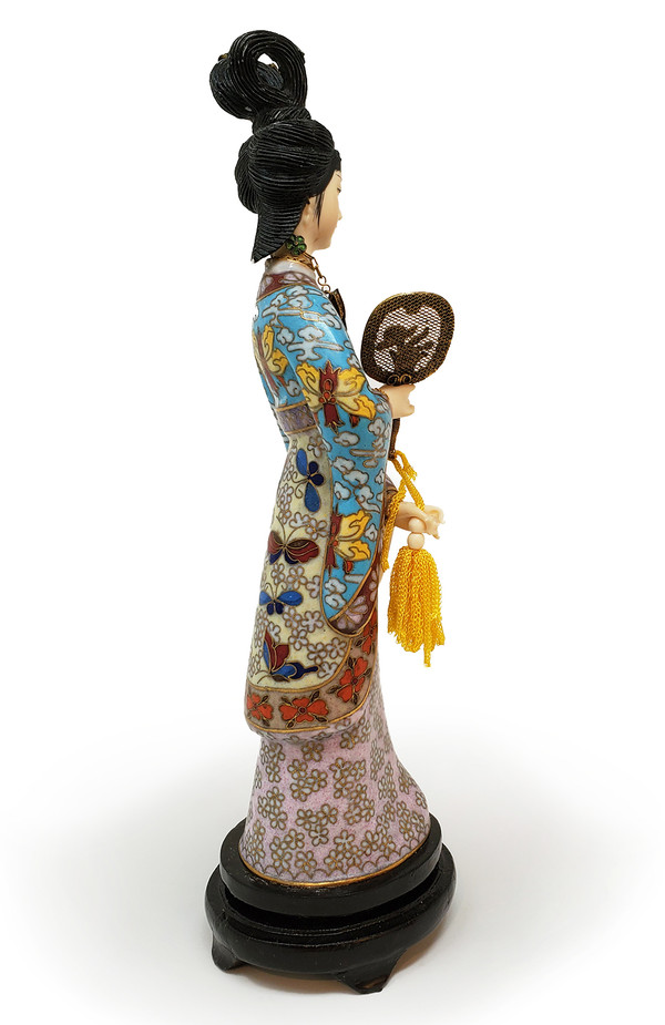 Japanese geisha statuette from the side.