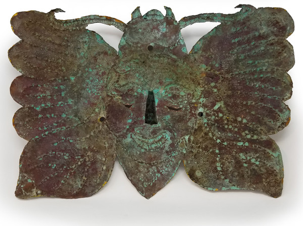 Reverse side of Mexican copper mask showing oxidation of metal.