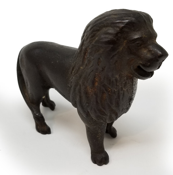 Lion-shaped coin bank.