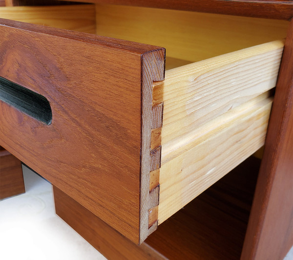 Vintage Norwegian side table with drawer open showing dovetail joinery.