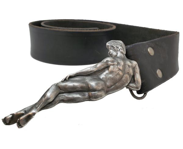 Vintage risque belt buckle on black leather belt.