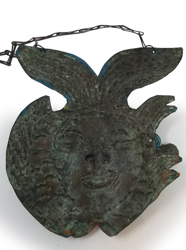 Reverse side of Mexican copper mask with aged patina.