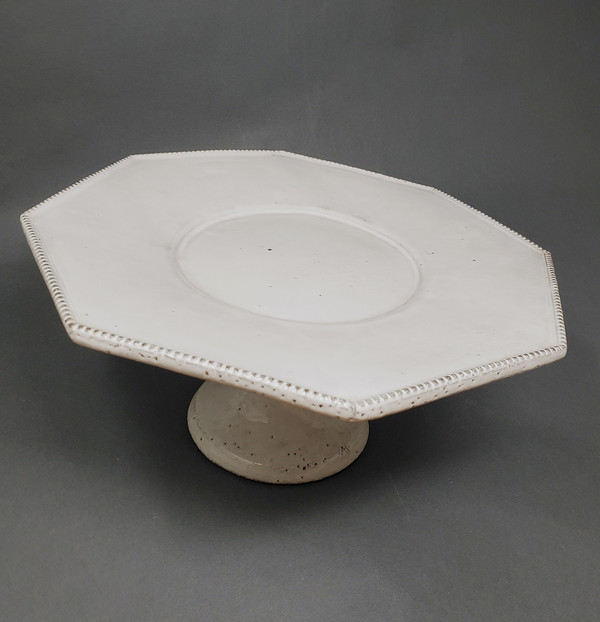 Black clay footed plate with white glaze by Astier de Villatte.
