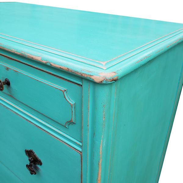 Corner detail of painted antique dresser.
