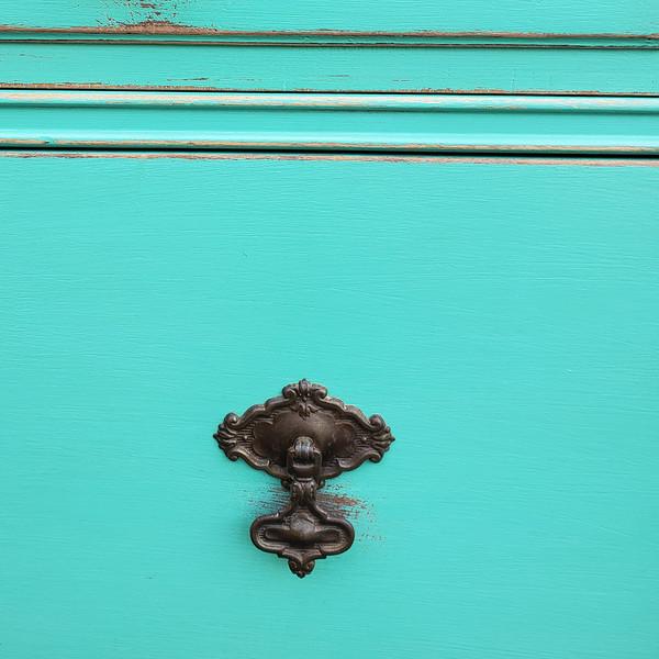 Original antique drawer handles on aqua painted dresser.