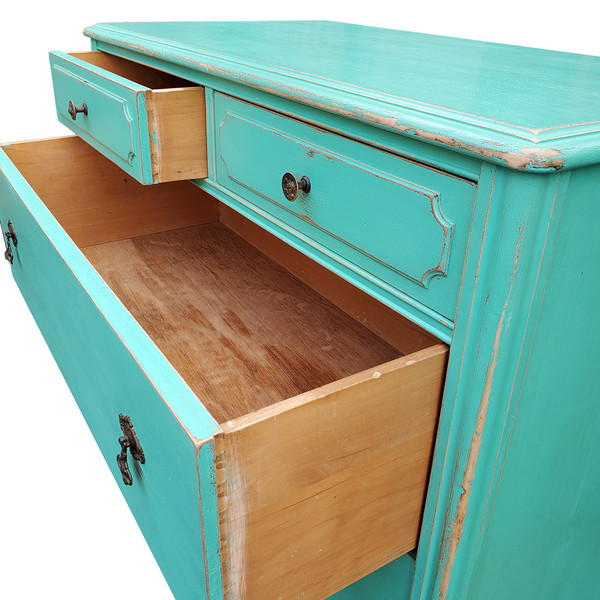 Aqua dresser with drawers open.
