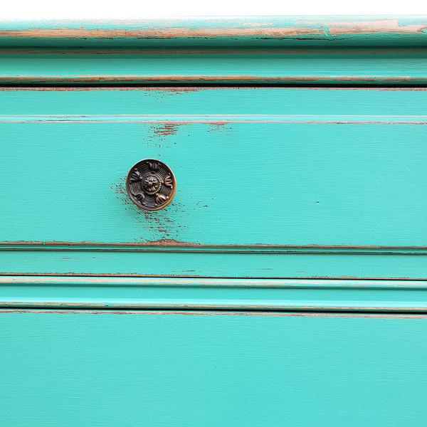 Drawer handle of handpainted dresser.