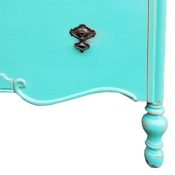 Turned foot detail of antique dresser.