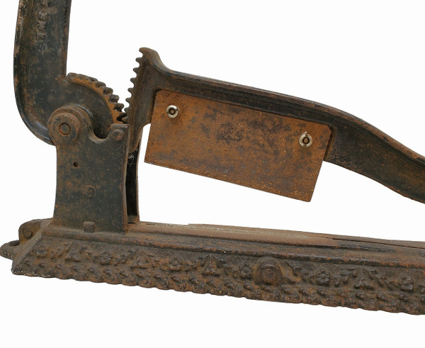 Blade of tobacco cutter with surface rust.