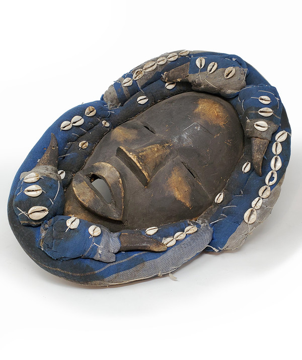 Wood and fabric African tribal mask.