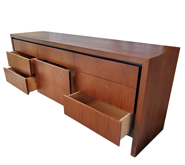 Walnut Milo Baughman dresser with drawers open.