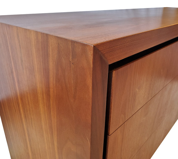 Corner detail of vintage walnut dresser.
