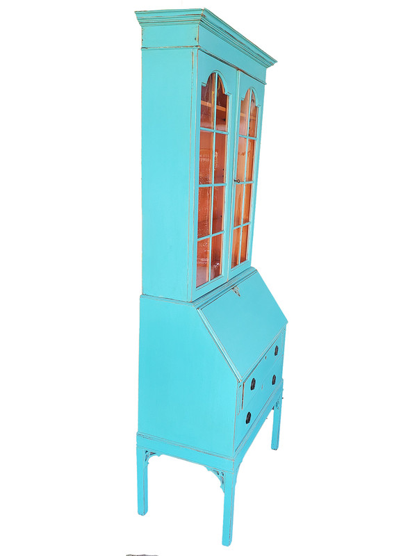 Side profile of turquoise painted secretary desk.