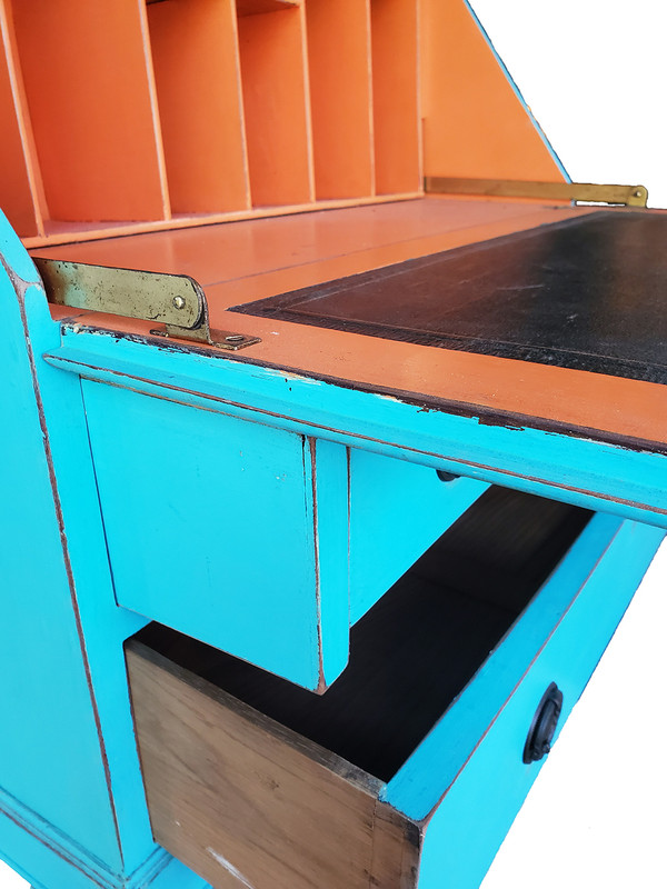 Secretary desk supports fully extended with writing desk resting on them.
